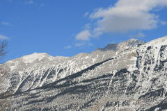 High mountains and clouds, canada. Jasper national park, alberta, canada, mountain range in snow Royalty Free Stock Image