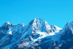 High mountains, covered by snow. Royalty Free Stock Photo