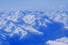 High mountains covered with snow. In winter Royalty Free Stock Photo