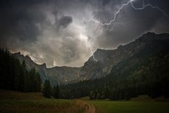 High Mountains Electric Storm. Scenery. Stormy and Dangerous Mountain Trail Stock Photo