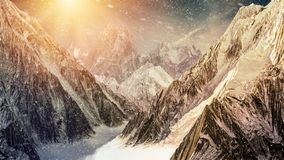 High mountains with falling snow stock photo