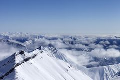 High mountains in haze. Caucasus Mountains. Royalty Free Stock Images