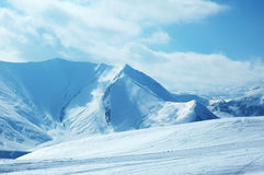 High mountains inter. High mountains under snow in the winter Royalty Free Stock Image