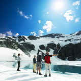 High mountains lake. People on the high mountains lake in Caucasus Stock Photography