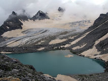 High mountains with lake Stock Images