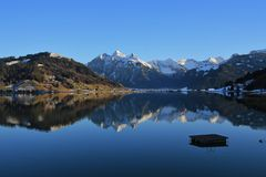 High mountains mirroring in lake Sihlsee. Lake near Einsiedeln, Swiss Alps. High mountains mirroring in lake Sihlsee Royalty Free Stock Photos