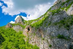 High in the mountains there are ancient caves. Royalty Free Stock Image