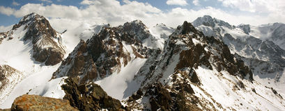 High mountains panorama. Panorama of high snowy and rocky mountains in North Tien Shan royalty free stock photo