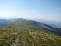 High mountains path in the Carpathian mountains, the West Ukraine. High mountains path scenery from Carpathian mountains, ridge Borzhava Stock Photos