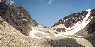 High mountains - retro filter photo. Uzunkol, Caucasus Mountains. Stock Image