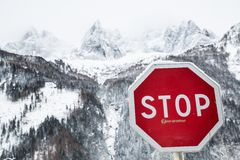 High mountains and stop sign Stock Photography