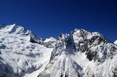 High Mountains in sunny day Royalty Free Stock Image