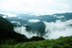 The high mountains tropical forest with clouds passing in India. Royalty Free Stock Images