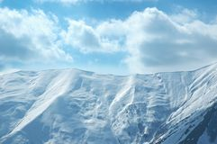 High mountains under snow. In the winter Stock Images