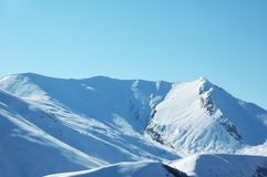 High mountains under snow. In the winter Royalty Free Stock Images