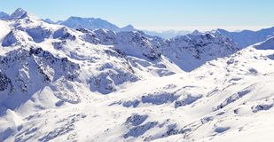 High mountains under snow in the winter. Slope on the skiing resort, European Alps.  Royalty Free Stock Images