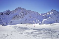High mountains under snow in the winter. Slope on the skiing resort, European Alps Stock Image