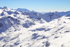 High mountains under snow in the winter. Slope on the skiing resort, European Alps Royalty Free Stock Image