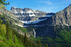 High mountains and waterfall near Logan Pass, Montana Stock Image