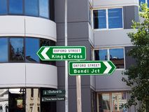 Oxford Street Kings Cross and Bondi Junction Road Signs, Sydney, Australia. High mounted traffic direction signs pointing to Kings Cross and Bondi Junction in stock photos
