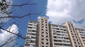High multi story building made of concrete plates with brown and white sky in summer. Wonderful view of a high multi study building made of concrete plates with stock footage