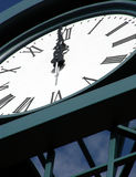 High Noon. Brand new clock tower erected at the top of high rise construction Royalty Free Stock Photo