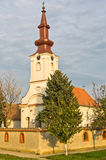 High noon on church tower clock. North Serbia Stock Photos