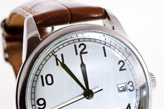 High noon. Detail of a watch at high noon royalty free stock image