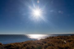 Shimmering waters, Lake McGregor Provincial Recreation Area, Alberta, Canada. The high noon sun shows the sparkling waters on lake mcgregor royalty free stock photo