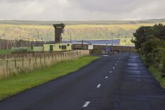 The high observation towers and security fencing at the entrance to the Magilligan Prison in County Londonderry Royalty Free Stock Photos