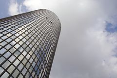 High office. Glass office building with sky and clouds in the background Stock Image
