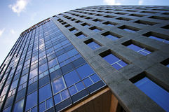 High office building. Reflecting clouds in the glass Royalty Free Stock Photos