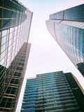 High office buildings. Bottom view of high skyscrapers. Triangular shape Royalty Free Stock Images