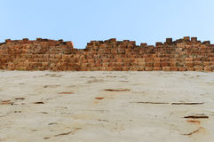 High Old brick wall blue sky background Royalty Free Stock Images