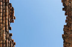 High Old brick wall blue sky background Stock Images