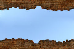 High Old brick wall blue sky background Stock Photo