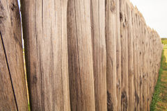 high old wooden fence of logs in form of palisade Royalty Free Stock Photos