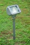 High output fluorescent light on grassland Royalty Free Stock Photo