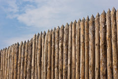 High paling. Traditional wooden rural wall from old logs Royalty Free Stock Image
