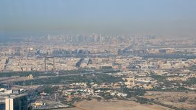 High panorama of modern city in sunny day, Dubai and Sharjah from Burj Khalifa. High panorama of modern city in sunny day, Dubai and Sharjah from observation stock video