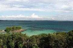High panoramic point of view looking over the turquoise tropical ocean horizon. High panoramic point of view looking over the turquoise tropical ocean horizon Royalty Free Stock Photography