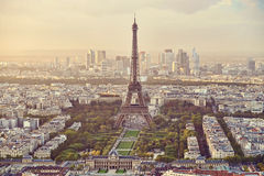 High panoramic view of the Eiffel Tower with Defense Business Center in the background. In Paris, France Royalty Free Stock Images