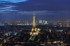 High panoramic view of the Eiffel Tower at night. A high panoramic view of the Eiffel Tower in Paris taken from the Montparnasse Tower at night Royalty Free Stock Photo