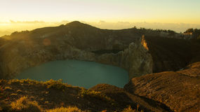 High panoramic view of the green turquoise colored lake in the Kelimutu volcano. High panoramic view of the green turquoise colored lake in the Kelimutu volcano Stock Photos