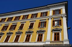 High part of the façade of an important building in Trieste in Friuli Venezia Giulia (Italy). Photo made at a large mansion in Trieste in Friuli Venezia stock photos