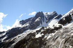 High peak. North Caucasus high mountain peaks on a daylight with snow stock images