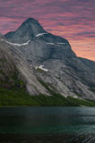 High peak and fjord at sunrise Stock Photo