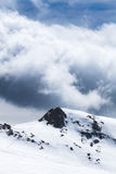 High peak of mountain on winter and ski traces Stock Photo