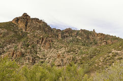 High Peaks of Pinnacles National Park. A panoramic outdoor vista view of a rugged western landscape and canyons with the sparse vegetation and surrounding Royalty Free Stock Image