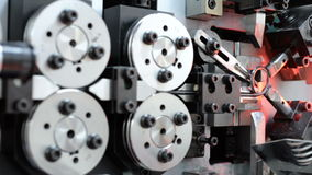 High-performance automatic machine for making steel springs. Linear panning left to right stock footage